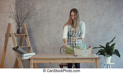 Florist arranging floristic tools and accessories - Lovely...