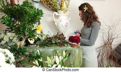 Florist Arranging Rose Heart