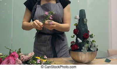 Florist brings floral bouquet of flowers for floristic composition