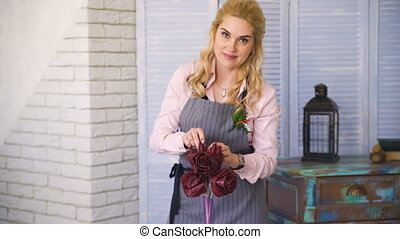 Florist chef woman making flowers of marshmallow for fruit and vegetable bouquet