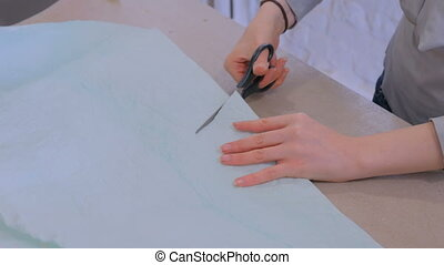 Florist cutting packing paper for bouquet at flower shop
