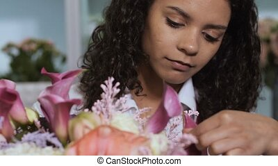 Florist finishing flower composition in workshop - Closeup...