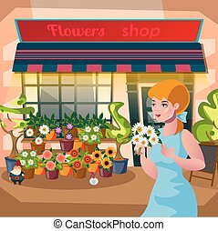 Florist girl holding a pot of flowers in the flower shop