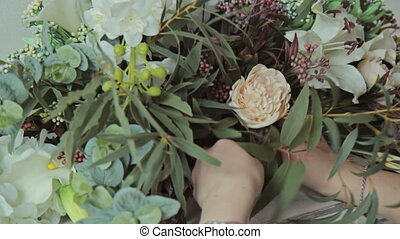 Florist girl making a flower composition