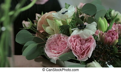 Florist hand make bouquets flowers in white box