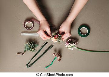Florist hands creating bouquet of flowers