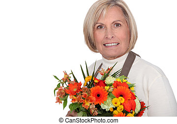 Florist holding a bouquet of flowers