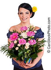 Florist holding beautiful roses arrangement