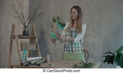 Florist holding freshly made flower bouquet - Cheerful...