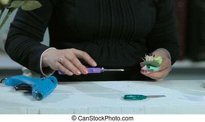 florist make bouquets with glue, scissors, pliers