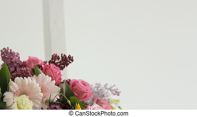 Florist makes photo on the phone of colorful bouquet composed of various flowers