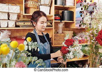 Florist making bouquet for customer