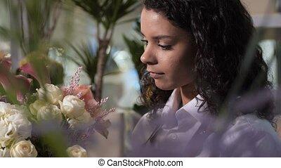 Florist making gorgeous bouquet in flower shop - Closeup of...