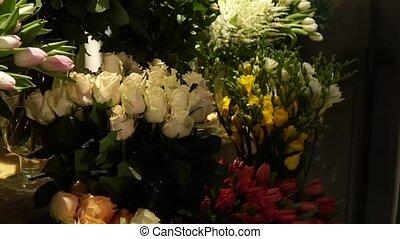 Florist prepares a bouquet of flowers for sale