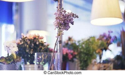 Florist putting pink and white flowers in a vase