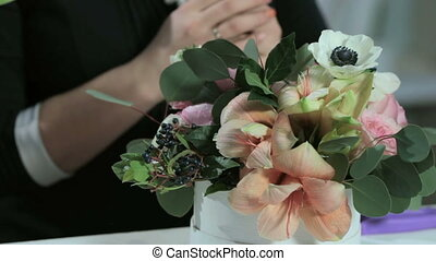 florist show talk about flower tulip and make bouquets in white box