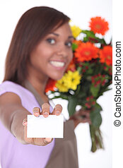 Florist showing business card female