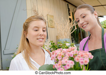Florist teaching a young intern