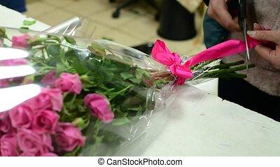 florist tie ribbon on a bouquet of pink roses - florist tie...
