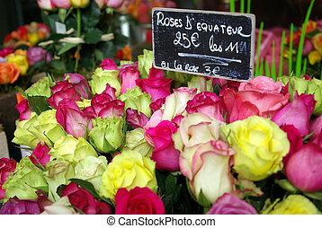 Close-up of a bouquet of roses in a florist store.