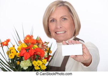 Florist with a blank card