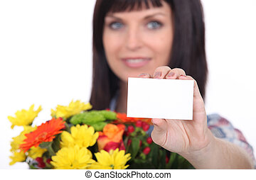 Florist with a bunch of flowers and a business card left blank for your message
