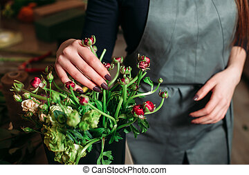 Florist with beautiful flowers.