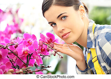 florist woman with flowers orchids