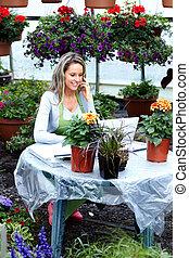 Florist woman working at flower shop.