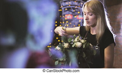 Florist working in her flower shop - Woman working in flower...
