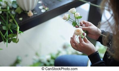 Florist working with roses