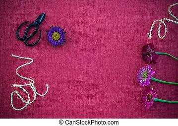 Florist workspace on magenta canvas background