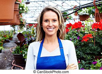Florists woman working at flower a shop. - Florists woman...