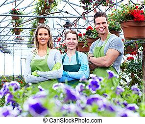 Florists working at flower shop.