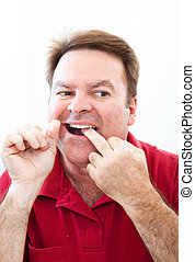 flossing teeth, man, spiegel