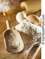 flour an eggs on board close up shoot