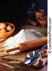 Flour and ingredients - Rolling pin and flour on an old ...