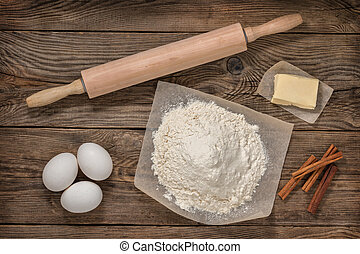 Flour, eggs, butter and cooking equipment. Cooking