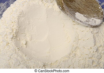 Flour in a bowl  ready for cooking and wooden spoon