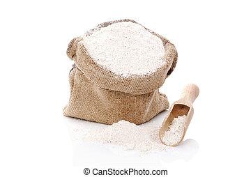 Flour in burlap bag. - White flour in brown burlap bag with...