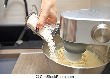 Flour pouring into food processor - Flour pouring into bowl...