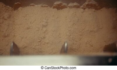 Flour processing in pasta production factory, close up