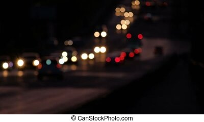 Flow of defocused car lights, commuters going back home