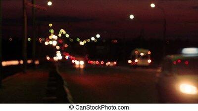 Flow of defocused lights on the night road - Flow of...
