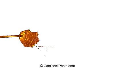 Flow of liquid like orange juice splattering on white...