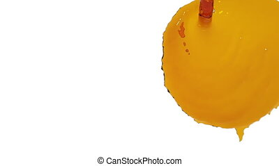 flow of orange fluid fills screen in slow motion