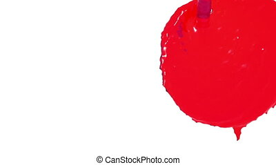 flow of red fluid fills the screen in slow motion. syrup