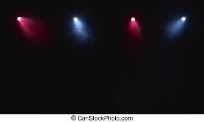 Flow of smoke through red blue the light of the laser lights on black background