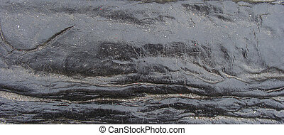 flow of wet shiny tar