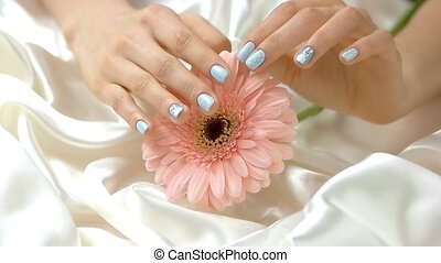 Flower and gentle touches of hand, slow motion. Young woman...